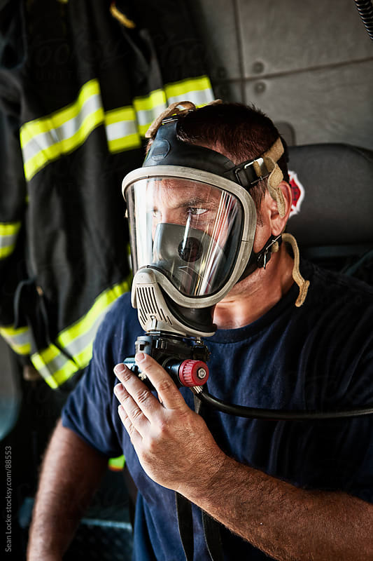 Firehouse: Fireman Testing Breathing Apparatus by Sean Locke for Stocksy United