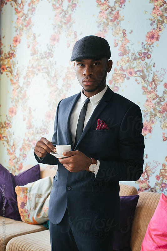 Stylish Young Black Man in Suit Holding Espresso Cup by Julien L. Balmer for Stocksy United