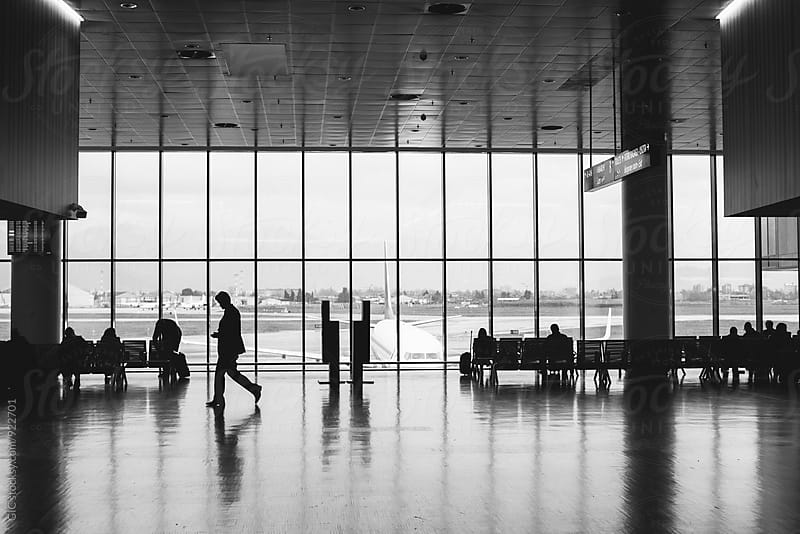 People at airport by GIC for Stocksy United