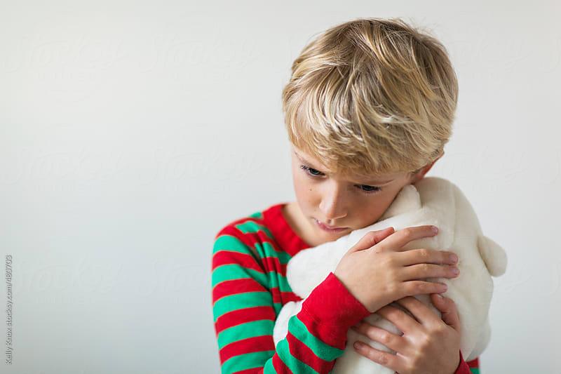 boy hugging a toy bear by Kelly Knox for Stocksy United