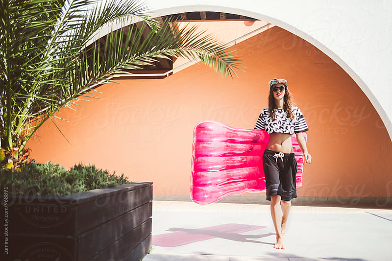 Fashion Model With a Sea Mattress at a Beach Hotel by Lumina for Stocksy United