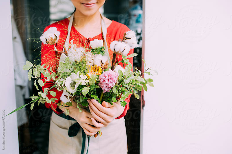 Florist Holding a Flower Bouquet