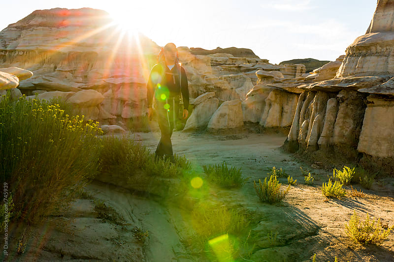 Hoodoos and Backpacker Hiking in Bisti Badlands Wilderness Area New Mexico at Sunrise by JP Danko for Stocksy United