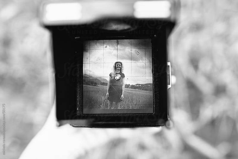 Smiling woman in a viewfinder by michela ravasio for Stocksy United