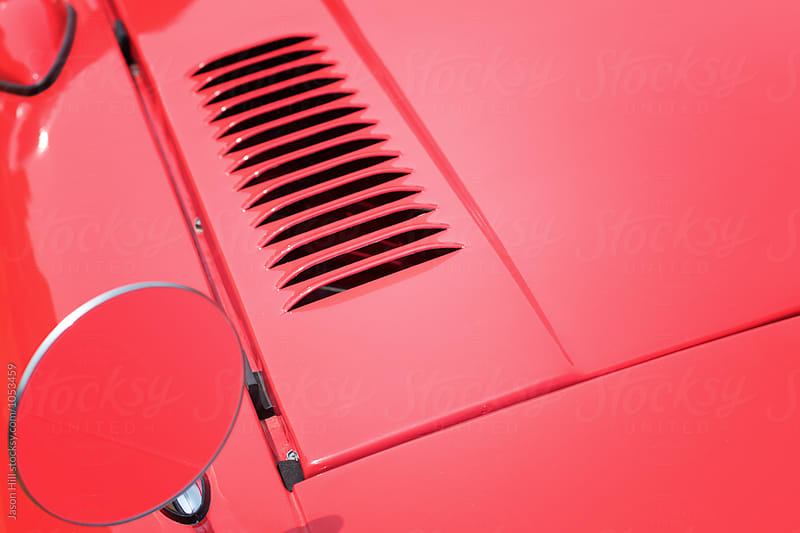 Close-up of a sports car by Jason Hill for Stocksy United