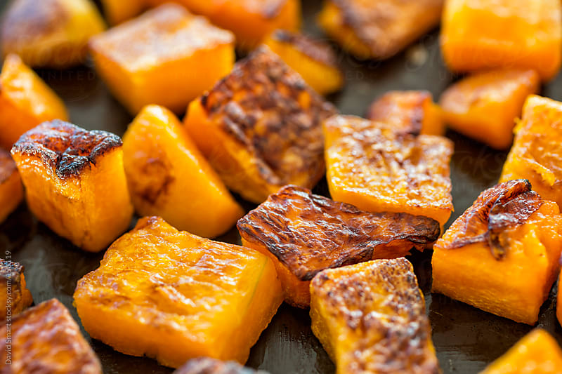Roasted Butternut Squash cubes on an a baking sheet by David Smart for Stocksy United
