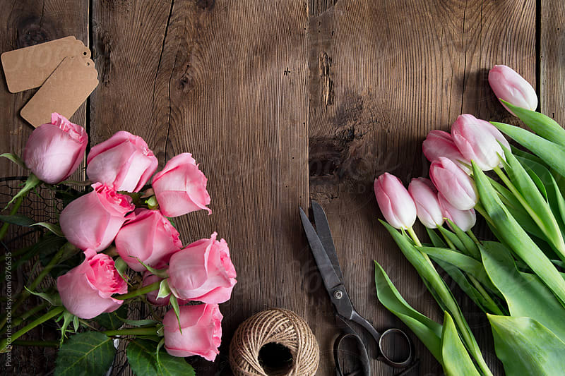 Making pink tulips and roses bouquet by Pixel Stories for Stocksy United