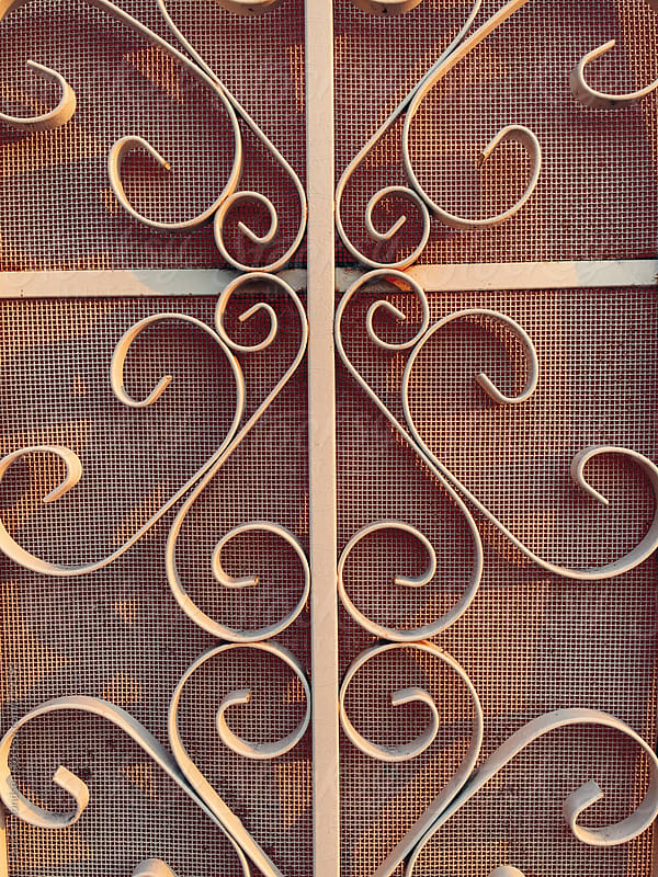 Detail of ornate metalwork on doorway, close up by Paul Edmondson for Stocksy United