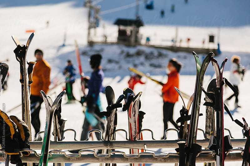 Ski Boards with Blurred People at Background by VICTOR TORRES for Stocksy United