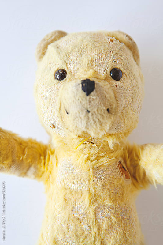 a well worn and loved old teddy bear by Natalie JEFFCOTT for Stocksy United