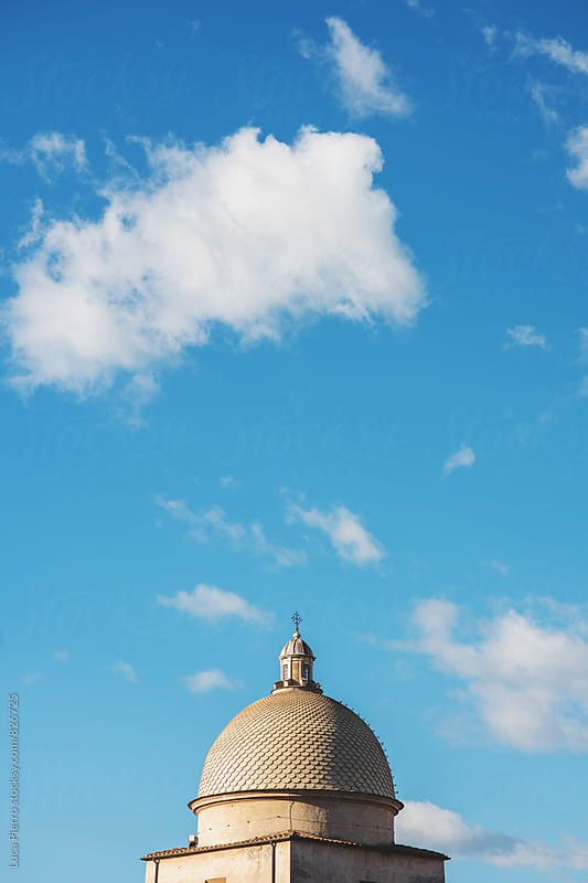 Camposanto dome relating to the blue sky, Pisa by Luca Pierro for Stocksy United