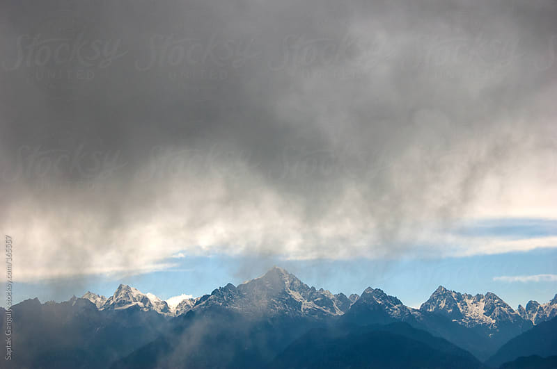 Dark clouds hovering over Mt. Kanchenjunga by Saptak Ganguly for Stocksy United