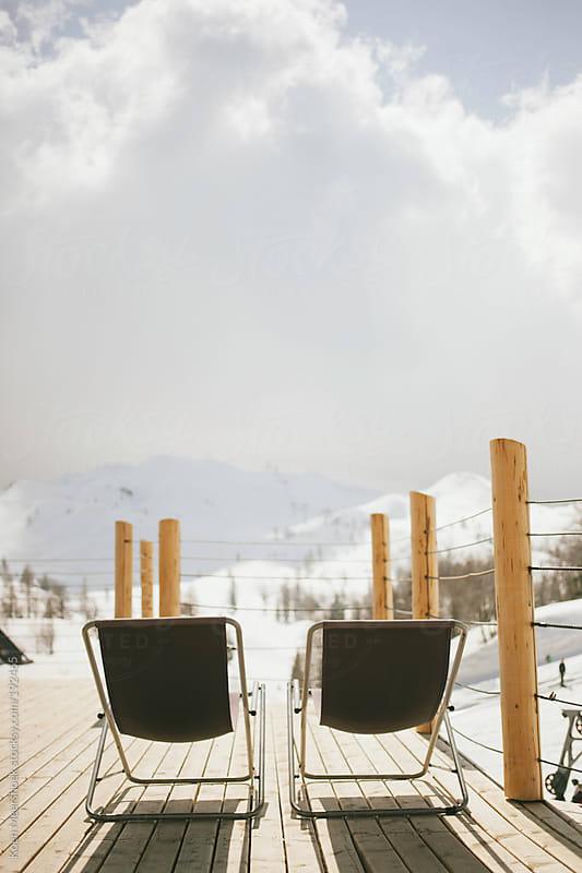 Two sun beds on a terrace in a ski area. by Koen Meershoek for Stocksy United