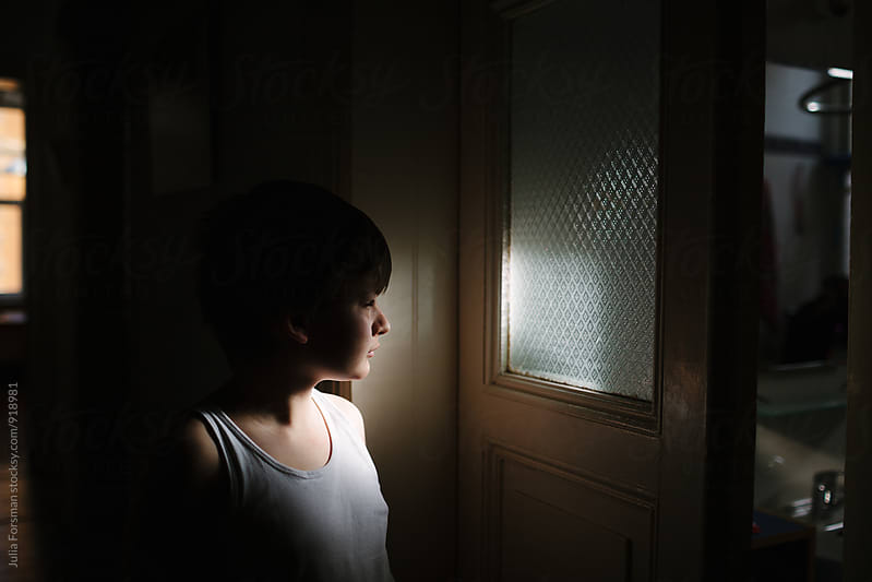 Tween boy walks towards the bathroom in the morning. by Julia Forsman for Stocksy United