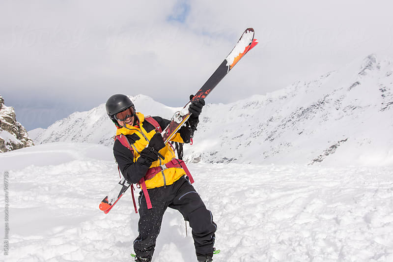 Skier playing rock and roll music on his skis by RG&B Images for Stocksy United