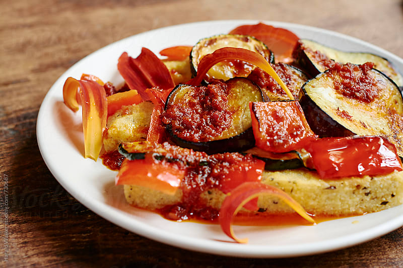 Grilled eggplant and red peppers by Harald Walker for Stocksy United