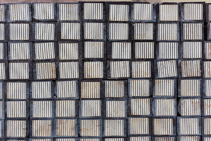 stack of railroad ties or sleepers by Deirdre Malfatto for Stocksy United
