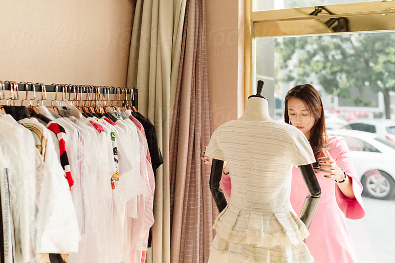 Young woman in her clothing store by MaaHoo Studio for Stocksy United