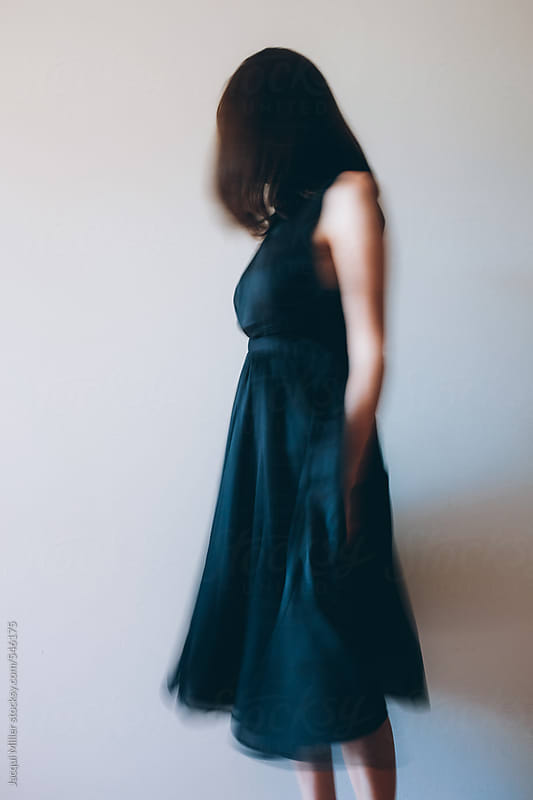 Side view of unrecognisable woman wearing an old fashioned flowing black dress by Jacqui Miller for Stocksy United