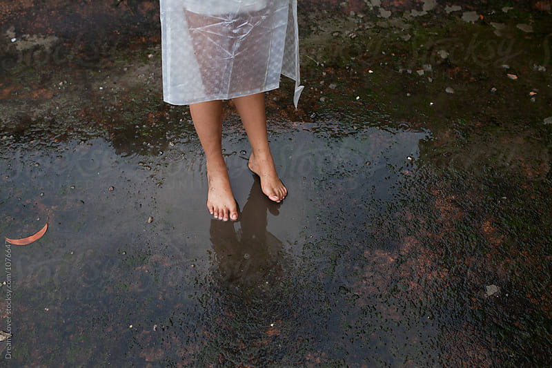 Feet of a teenage girl wet with rain by PARTHA PAL for Stocksy United