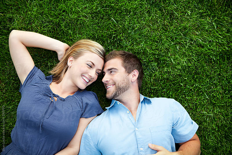 Grass: Couple Lies Face to Face in Grass by Sean Locke for Stocksy United