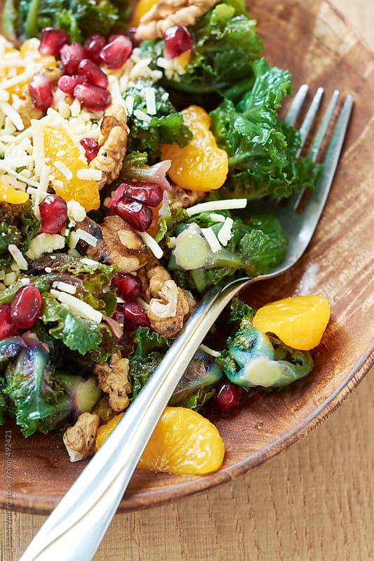 Sprout Flower Salad with Walnuts and Pomegranate Arils by Harald Walker for Stocksy United