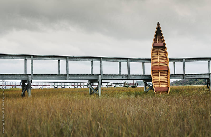 Handmade Canoe in Marsh by Raymond Forbes LLC for Stocksy United