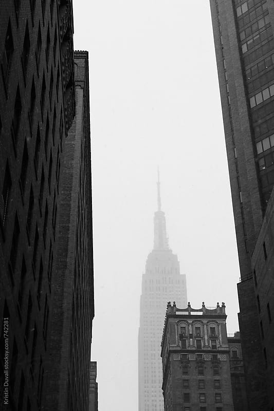 Empire State Building in winter snow. New York City. by Kristin Duvall for Stocksy United