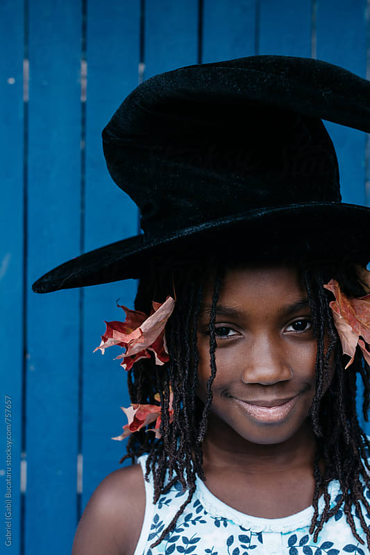 Black girl and witche's hat by Gabriel (Gabi) Bucataru for Stocksy United