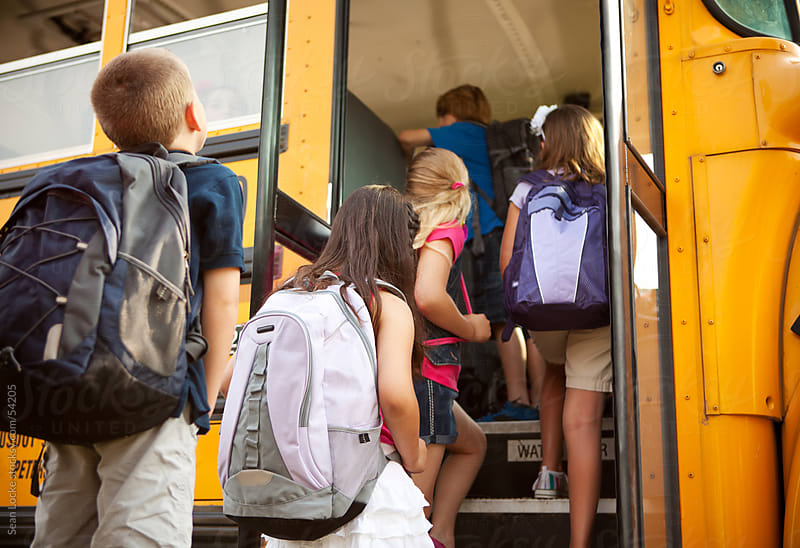 School Bus: Students Boarding the Bus by Sean Locke for Stocksy United