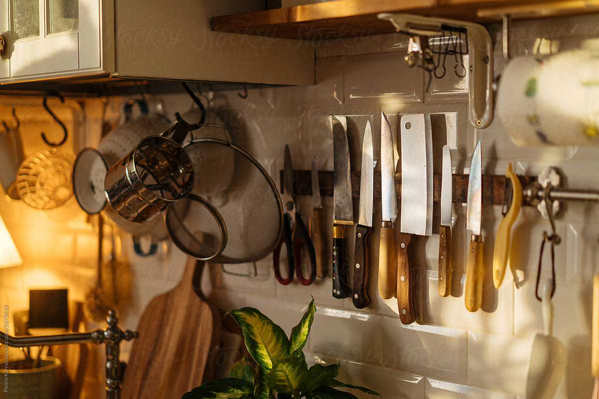 Kitchen With Various Utensils Hanging On Wall By Pietro Karras