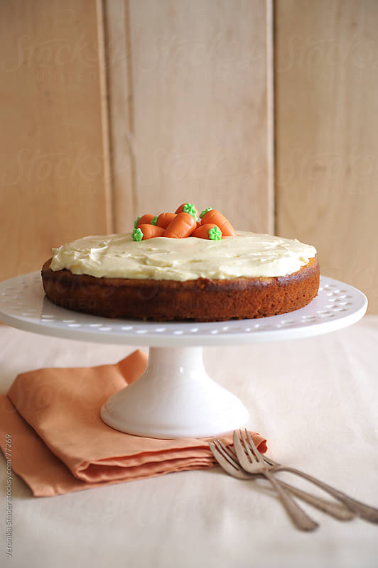 Carrot cake on stand by Veronika Studer for Stocksy United