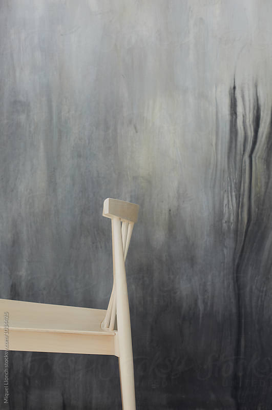 Wooden chair and abstract painting by Miquel Llonch for Stocksy United