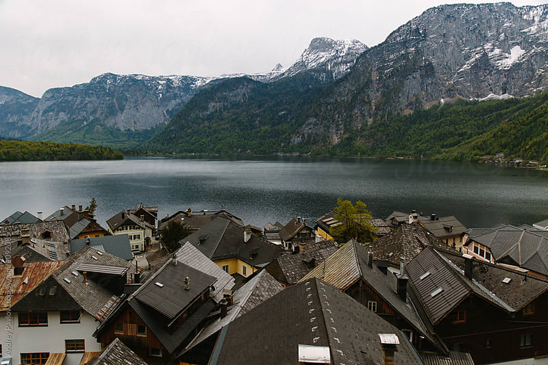Austrian village with calm lake in mountains by Andrey Pavlov for Stocksy United