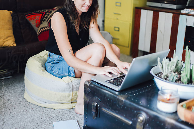 woman working on computer at home by Treasures & Travels for Stocksy United