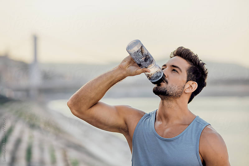Athlete Drinks Water During a Workout by Lumina for Stocksy United