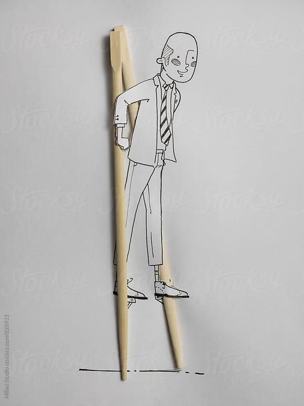 Man on Stilts  by Milles Studio for Stocksy United