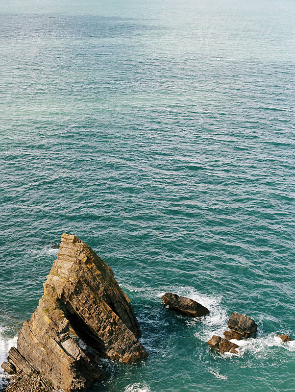 Rocks off the coast of Devon.  by Kirstin Mckee for Stocksy United