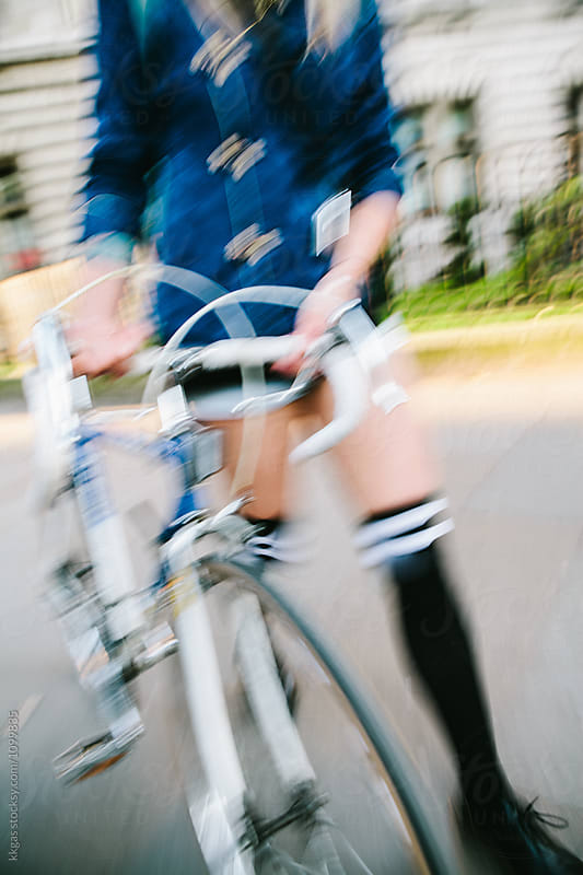 Motion blur of a womans legs with bicycle in the street by kkgas for Stocksy United