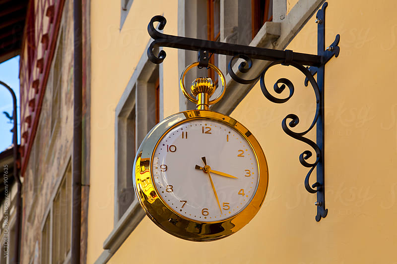 Gold clock in the streets of Stein Am Rhein by Victor Torres for Stocksy United