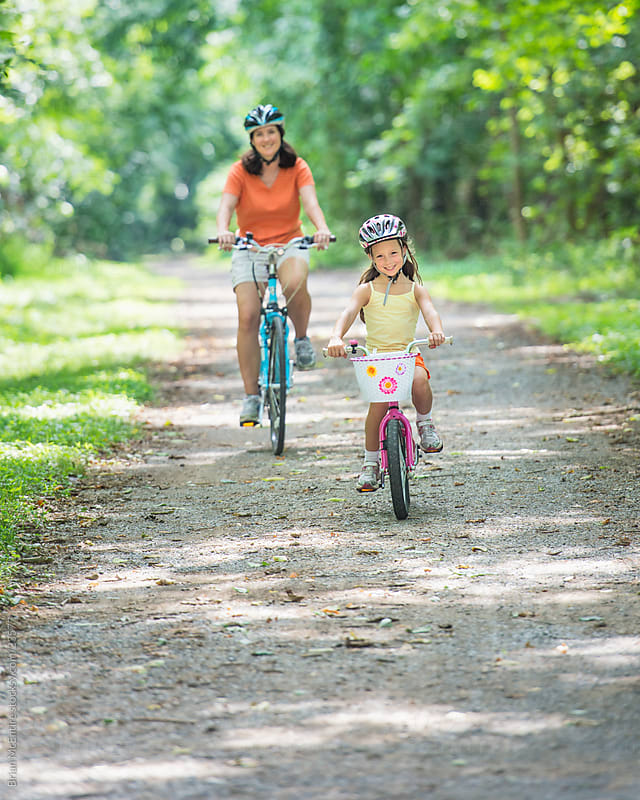 Family Biking on Wooded Path by Brian McEntire for Stocksy United