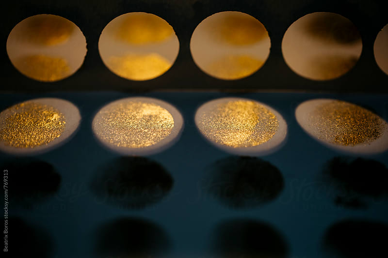 Golden paint circular abstract with shadows and light by Beatrix Boros for Stocksy United