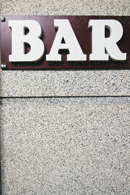 Bar sign with granite rock by Alejandro Moreno de Carlos for Stocksy United