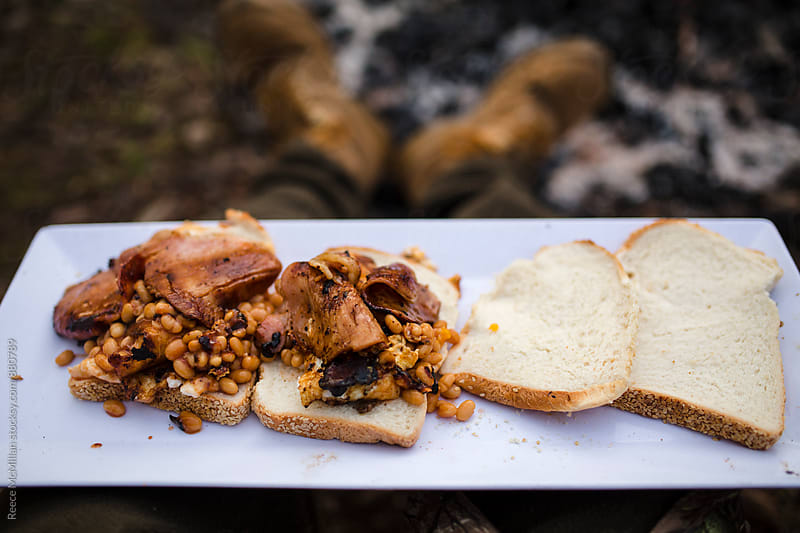 Campfire breakfast by Reece McMillan for Stocksy United