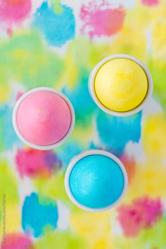 Easter eggs on colorful cloth by Pixel Stories for Stocksy United