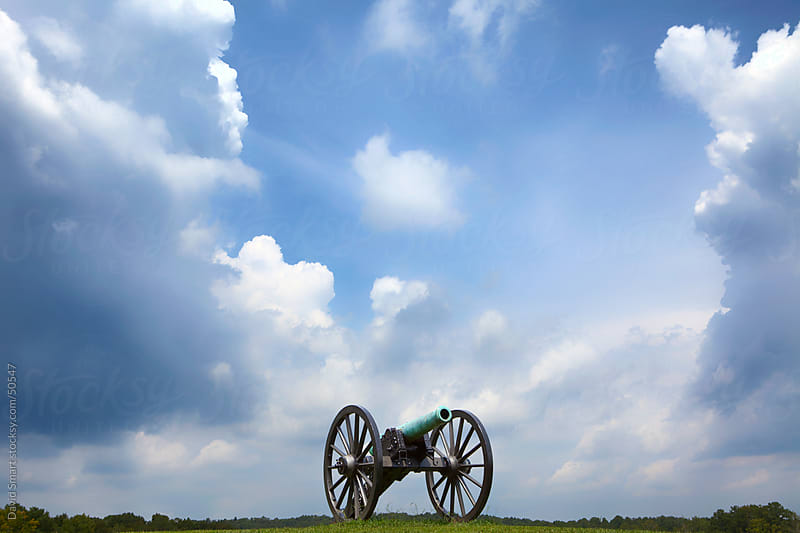 Civil War  cannon with storm clouds in Chickamauga National Military Park by David Smart for Stocksy United