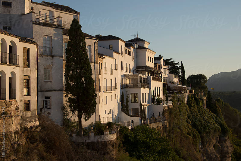 Shot of buildings on the edge of a gorge in Ronda, Spain. by Mike Marlowe for Stocksy United