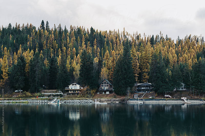 Vacation cabins on a river by Justin Mullet for Stocksy United