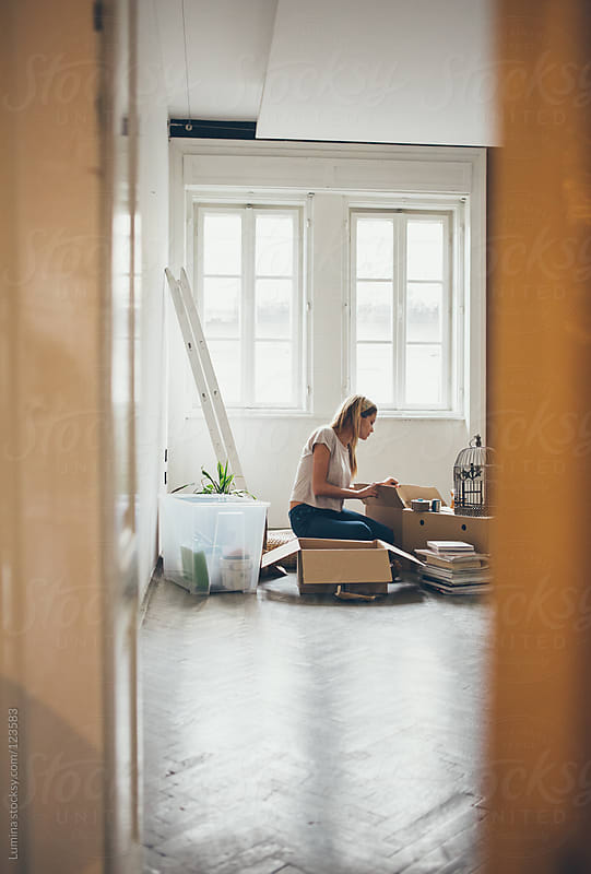 Woman Unpacking After Moving In by Lumina for Stocksy United