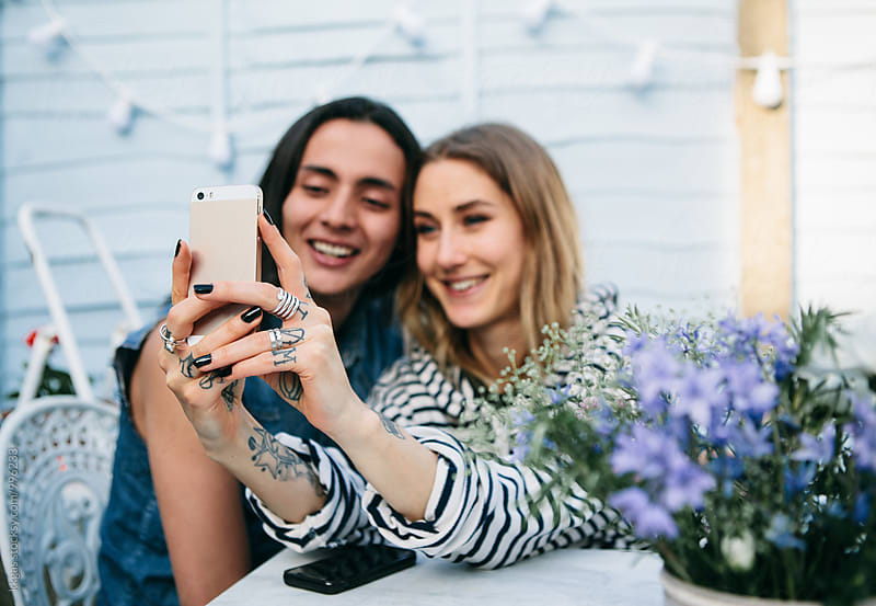 Young couple taking a selfie on a summer day by kkgas for Stocksy United